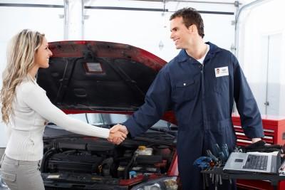 Girl shaking hand with Car Mechanic